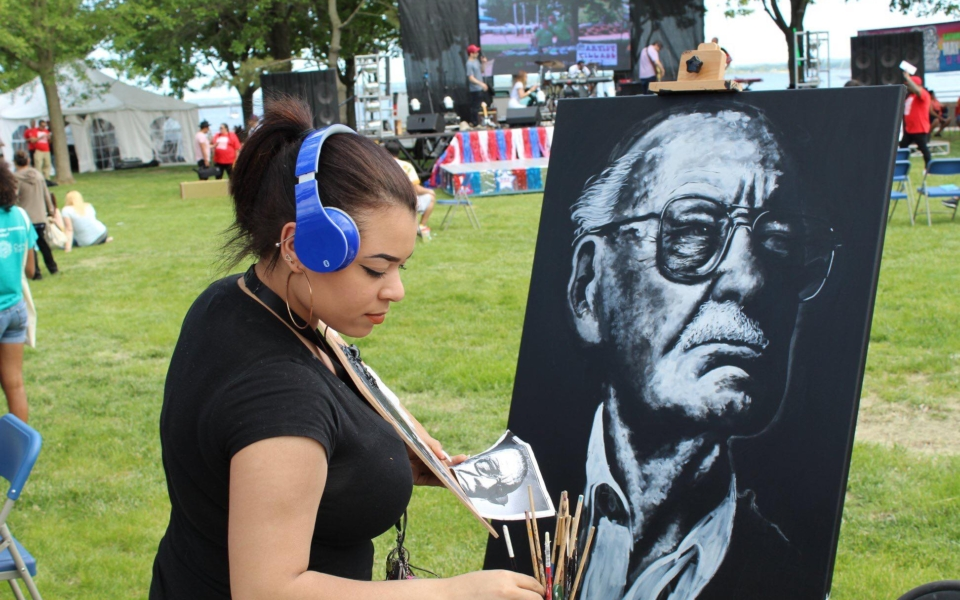 Solange Pena live paints portrait of Stan Lee at the Waterfront Arts Festival in Perth Amboy